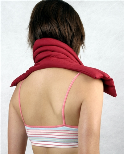 woman with heat pack on shoulders